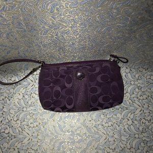 Purple Coach wristlet 🌺